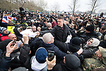 "© Joel Goodman - 07973 332324. 18/03/2018 . London , UK . TOMMY ROBINSON (centre) hands out copies of the speech to the crowd . 1000s including supporters of alt-right groups such as Generation Identity and the Football Lads Alliance , at Speakers' Corner in Hyde Park where Tommy Robinson reads a speech by Generation Identity campaigner Martin Sellner . Along with Brittany Pettibone , Sellner was due to deliver the speech last week but the pair were arrested and detained by police when they arrived in the UK , forcing them to cancel an appearance at a UKIP "" Young Independence "" youth event , which in turn was reportedly cancelled amid security concerns . Photo credit : Joel Goodman"