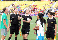 Abby Wambach #20 of Abby's XI and Marta #10 of Marta's XI watch the coin toss during the WPS All-Star game at KSU Stadium in Kennesaw, Georgia on June 30 2010. Marta XI won 5-2.