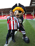 Captain Blades with guest during the English League One match at the Bramall Lane Stadium, Sheffield. Picture date: November 19th, 2016. Pic Simon Bellis/Sportimage