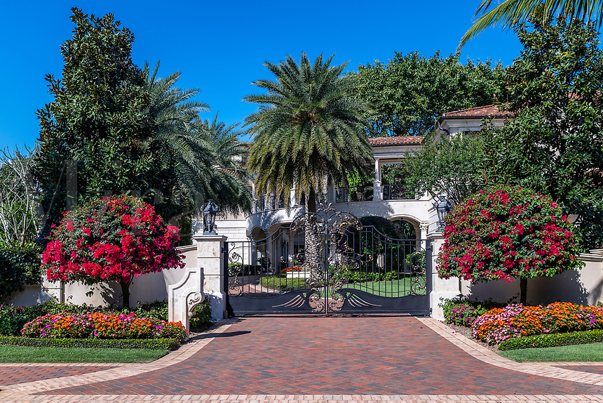 High end estate and security gate, Naples, Florida, USA.