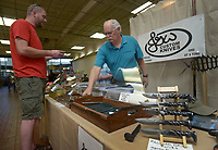 NWA Democrat-Gazette/BEN GOFF @NWABENGOFF<br /> Patrick Clanton (left) of Pea Ridge looks at custom knives made by Jack Waxenfelter of Berryville Sunday, May 7, 2017, during the spring Frisco Station Mall Arts and Crafts Festival in Rogers.