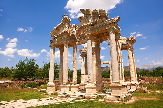 "Picture of the double Tetrapylon Gate, Aphrodisias, Turkey. A tetrapylon (Greek: Τετράπυλον, ""four gates"") is an ancient type of Roman monument of cubic shape, with a gate on each of the four sides: generally it was built on a crossroads. stock photos & photo art prints. 3"
