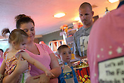 The Kannard family, left to right: Hope (17 months), Samantha, Nathan (7 years), and DJ of Strasburg, Virginia pay for concessions at Family Drive-In Theatre in Stephens City, Virginia on July 20, 2013. CREDIT: Lance Rosenfield/Prime