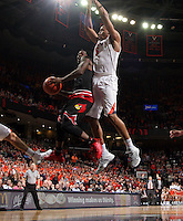 Louisville guard Terry Rozier (0) shoots next to Virginia forward Darion Atkins (5) during the game Saturday Feb. 7, 2015, in Charlottesville, Va. Virginia defeated Louisville  52-47. (Photo/Andrew Shurtleff)