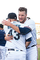 Peoria Javelinas pitcher Adam McCreery (48), of the Atlanta Braves organization, hugs manager Daren Brown (43) after winning the Arizona Fall League Championship game against the Salt River Rafters at Scottsdale Stadium on November 17, 2018 in Scottsdale, Arizona. Peoria defeated Salt River 3-2 in 10 innings. (Zachary Lucy/Four Seam Images)