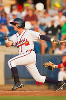 Matt Weaver #9 of the Rome Braves follows through on his swing against the Greenville Drive at State Mutual Stadium July 24, 2010, in Rome, Georgia.  Photo by Brian Westerholt / Four Seam Images