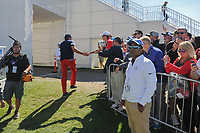 Phil Mickelson (USA) shakes hands with the crowd on his way to the driving range to warm up during round 4 Singles of the 2017 President's Cup, Liberty National Golf Club, Jersey City, New Jersey, USA. 10/1/2017. <br /> Picture: Golffile | Ken Murray<br /> <br /> All photo usage must carry mandatory copyright credit (&copy; Golffile | Ken Murray)