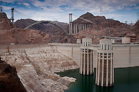 Hoover Dam, once known as Boulder Dam, is a concrete arch-gravity dam in the Black Canyon of the Colorado River, on the border between the U.S. states of Arizona and Nevada. When completed in 1936, it was both the world's largest hydroelectric power generating station and the world's largest concrete structure.