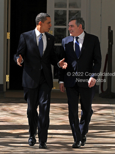 Washington, D.C. - March 3, 2009 -- United States President Barack Obama (L) and Prime Minister Gordon Brown of Great Britain (R) walk along the colonnade after a meeting in the Oval Office at the White House on Tuesday, March 3, 2009 in Washington DC. Brown will also participate in a working lunch with president Obama before he departs the White House. .Credit: Kevin Dietsch / Pool via CNP