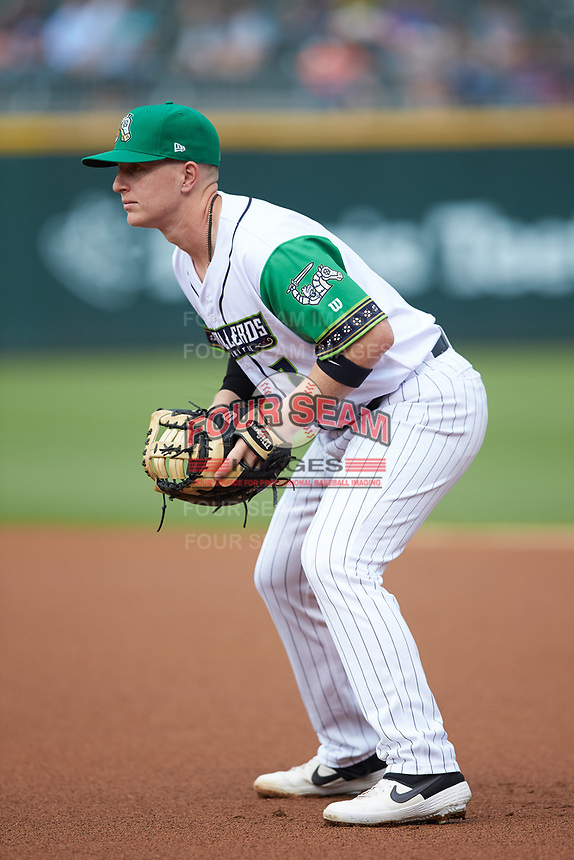 Caballeros de Charlotte first baseman Zack Collins (8) on defense against the Buffalo Bisons at BB&T BallPark on July 23, 2019 in Charlotte, North Carolina. The Bisons defeated the Caballeros 8-1. (Brian Westerholt/Four Seam Images)