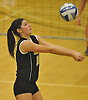 Wantagh No. 18 Jaimie Reich makes a set during the Nassau County varsity girls' volleyball Class A final against Long Beach at SUNY Old Westbury on Wednesday, Nov. 11, 2015. Wantagh won 3-0.<br /> <br /> James Escher