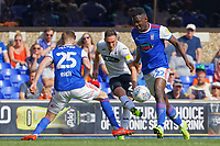 Connor Roberts of Swansea City (C) gets a cross through two Ipswich players during the Sky Bet Championship match between Ipswich Town an Swansea City at Portman Road Stadium, Ipswich, England, UK. Monday 22 April 2019