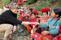 Backroads Active Travel hikers donates food to the children of Huilloc, as a thank you for welcoming them into the Andean community and teaching them about their weaving tradition and culture. The kids are pleased to be given these nutritious foods and appreciate the group's company.