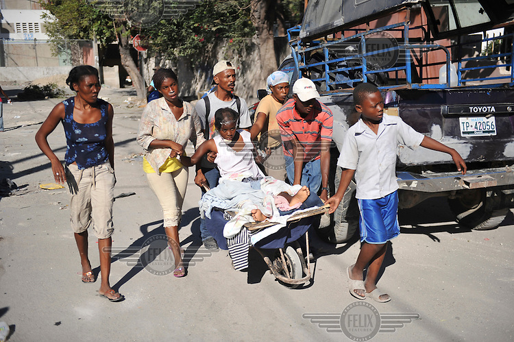 Wounded people are brought to makeshift hospitals four days after the earthquake hit Port-au-Prince. There is hardly any medical care in the city as most hospitals have collapsed..A 7.0 magnitude earthquake struck Haiti on 12/01/2010. Early reports indicated that more than 100,000 may have been killed and three million affected.