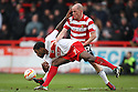 Iain Hume of Doncaster tackles Anthony Grant of Stevenage. Stevenage v Doncaster Rovers - npower League 1 -  Lamex Stadium, Stevenage - 12th January, 2013. © Kevin Coleman 2013.