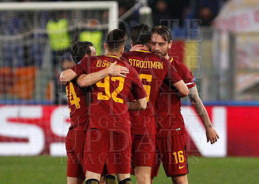 Roma players, from left, Alessandro Florenzi, Stephan El Shaarawy, Kevin Strootman and Daniele De Rossi celebrate at the end of the Uefa Champions League round of 16 second leg soccer match between Roma and Shakhtar Donetsk at Rome's Olympic stadium, March 13, 2018. Roma won. 1-0 to join the quarter finals.<br /> UPDATE IMAGES PRESS/Riccardo De Luca