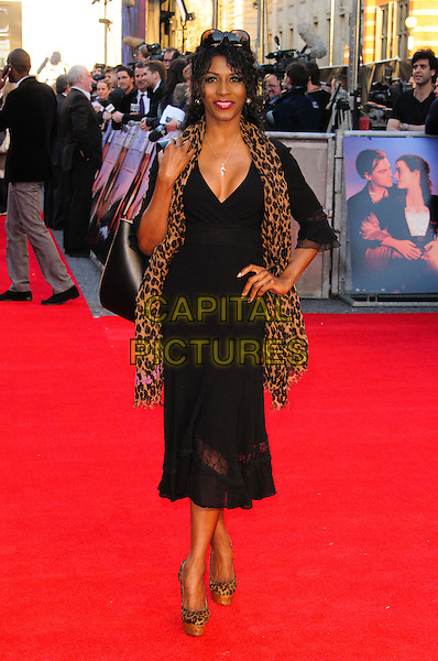 Sinitta Renet Malone.'Titanic 3D' world premiere, Royal Albert Hall, London, England..27th March 2012.full length black top dress brown leopard print hand on hip.CAP/CJ.©Chris Joseph/Capital Pictures.
