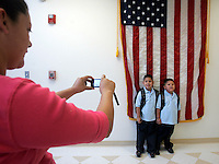 LOS ANGELES, CA- SEPTEMBER 3, 2008:  First day of school photographs for Joshua and Bryan Cuadra, Sept. 3, 2008.  Proud mom, Yuliana Valenzuela, left, takes a first day of school photograph at Aldama Elementary. A group of Highland Park parents wanted to improve their local elementary school, Aldama. After two years of work, the school will start an ambitious billingual pre-school/elementary program.