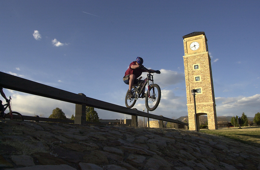 Mountian biker Paul Smith hops a rail in an urban assault mission at Fort Lewis College in Durango, Colorado in 2002.
