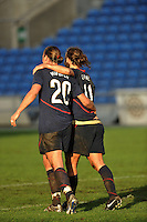 Abby Wambach (left, #20) and Lauren Cheney (right, #11) celebrate Cheney's game winning goal.  The USA captured the 2010 Algarve Cup title by defeating Germany 3-2, at Estadio Algarve on March 3, 2010.