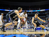 Ashton Gibbs (center) of the Panther contains the loose ball. Butler upset no.1 seed Pittsburgh 71-70 during the 3rd round of the NCAA Tournament at the Verizon Center in Washington, D.C on Saturday, March 19, 2011. Alan P. Santos/DC Sports Box