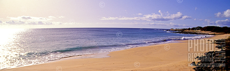 A beautiful stretch of an empty sandy beach on the remote island of Kahoolawe.