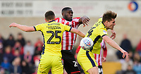 Lincoln City's John Akinde vies for possession with Cheltenham Town's Jordan Tillson, left, and Cheltenham Town's Charlie Raglan<br /> <br /> Photographer Chris Vaughan/CameraSport<br /> <br /> The EFL Sky Bet League Two - Lincoln City v Cheltenham Town - Saturday 13th April 2019 - Sincil Bank - Lincoln<br /> <br /> World Copyright © 2019 CameraSport. All rights reserved. 43 Linden Ave. Countesthorpe. Leicester. England. LE8 5PG - Tel: +44 (0) 116 277 4147 - admin@camerasport.com - www.camerasport.com