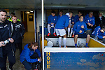 The home team substitutes and backroom staff cram themselves into the home dugout before Greenock Morton take on Stranraer in a Scottish League One match at Cappielow Park, Greenock. The match was between the top two teams in Scotland's third tier, with Morton winning by two goals to nil. The attendance was 1,921, above average for Morton's games during the 2014-15 season so far.