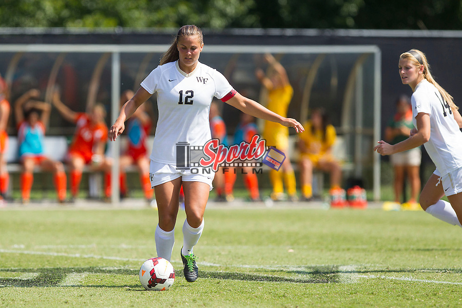 Katie Stengel (12) of the Wake Forest Demon Deacons controls the ball during second half action against the Miami Hurricanes at Spry Soccer Stadium on September 15, 2013 in Winston-Salem, North Carolina.  The Deacons defeated the Hurricanes 4-0.   (Brian Westerholt/Sports On Film)