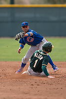 Chicago Cubs shortstop Aramis Ademan (11) gets the force out at second base in front of Nick Allen (1) during a Minor League Spring Training game against the Oakland Athletics at Sloan Park on March 13, 2018 in Mesa, Arizona. (Zachary Lucy/Four Seam Images)