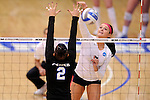 03 DEC 2011:  Ashley Murtha (7) of Concordia University St. Paul hits a kill over Camille Smith (2) of Cal State San Bernardino during the Division II Women's Volleyball Championship held at Coussoulis Arena on the Cal State San Bernardino campus in San Bernardino, Ca. Concordia St. Paul defeated Cal State San Bernardino 3-0 to win the national title. Matt Brown/ NCAA Photos