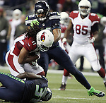 Seattle Seahawks linebacker  K.J. Wright (50) and strong safety Kam Chancellor (31) team up to stop Arizona Cardinals wide receiver Larry Fitzgerald at CenturyLink Field in Seattle, Washington on November 15, 2015. The Cardinals beat the Seahawks 39-32.   ©2015. Jim Bryant photo. All Rights Reserved.