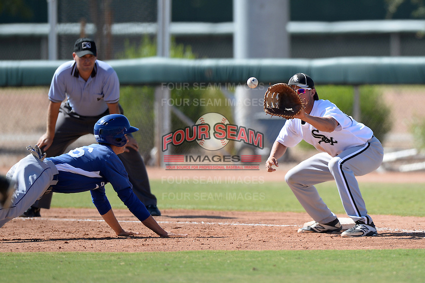Chicago White Sox catcher Michael Marjama (25) takes a pick off attempt throw as Cody Bellinger (76) dives back to first during an Instructional League game against the Los Angeles Dodgers on October 12, 2013 at Camelback Ranch Complex in Glendale, Arizona.  (Mike Janes/Four Seam Images)