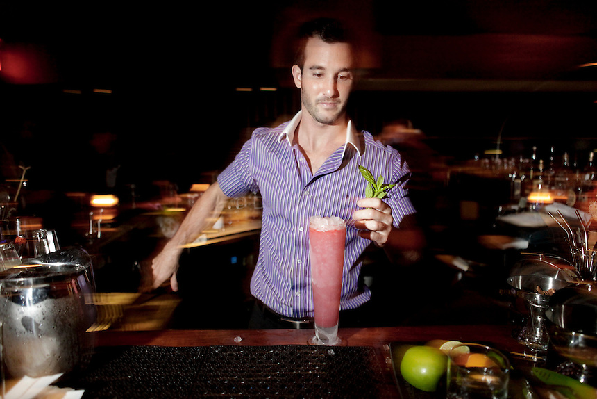 Dave Stuart prepares a Jbird Swizzle at Jbird cocktails in midtown Manhattan on Friday September 16, 2011. ..Danny Ghitis for The New York Times