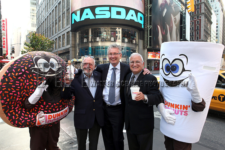 Harold Prince & Nigel Travis & John Costello joins Dunkin Donuts to celebrate 'National Donut Day' as well as unveiling their new Electronic Billboard in Times Square, New York on 6/1/2012© Walter McBride .