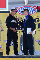 Oct. 28, 2012; Las Vegas, NV, USA: NHRA announcer Bob Frey (right) interviews Eddie Krawiec during the Big O Tires Nationals at The Strip in Las Vegas. Mandatory Credit: Mark J. Rebilas-