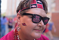 NWA Democrat-Gazette/CHARLIE KAIJO Angie Snow of McGehee, Ark. shows off her Hogs gear before a football game, Saturday, September 7, 2019 at Vaught-Hemingway Stadium in Oxford, Miss.