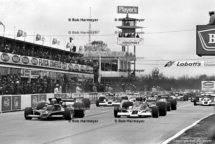 BOWMANVILLE, ONT - OCTOBER 9: Mario Andretti (#5) starts the Canadian Grand Prix from pole position on October 9, 1977, at Mosport Park near Bowmanville, Ontario.