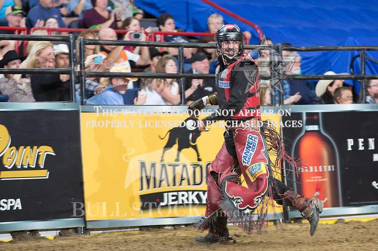 Alex Cardozo rides Outlaw  ( Mike Miller/Torres Bros ) for 86 during the second round ( Short-Go ) of the PBR Real Time Pain Relief Velocity Tour event in Albany, NY - Photo by Andre Silva
