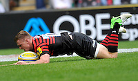 London, England. Chris Ashton of Saracens scores a try during the Aviva Premiership match between London Wasps  and Harlequins at Twickenham Stadium on September 1, 2012 in Twickenham, England.