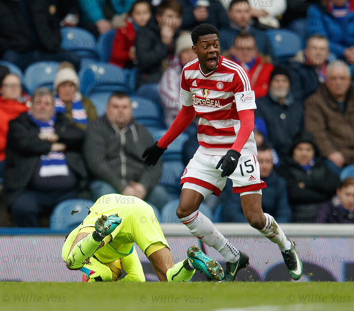 Wes Foderingham collects the ball ahead of Rakish Bingham who appeals to the officials he is out of his area