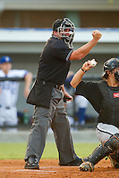 Home plate umpire Jeremy Riggs makes a strike call during an Appalachian League game between the Bristol White Sox and the Burlington Royals at Burlington Athletic Stadium August 13, 2010, in Burlington, North Carolina.  Photo by Brian Westerholt / Four Seam Images