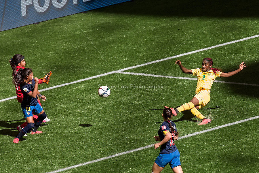 June 8, 2015: Madeleine NGONO MANI of Cameroon kicks and scores a goal during a Group C match at the FIFA Women's World Cup Canada 2015 between Cameroon and Ecuador at BC Place Stadium on 8 June 2015 in Vancouver, Canada. Sydney Low/AsteriskImages