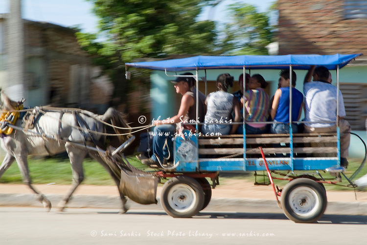 Horse pulling a public transport coach full of passengers outside Trinidad, Cuba.