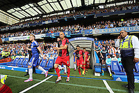 Pictured L-R: Chelsea and Swansea teams exit the tunnel, led by Andre Schurrle and Jonjo Shelvey. Saturday 13 September 2014<br />