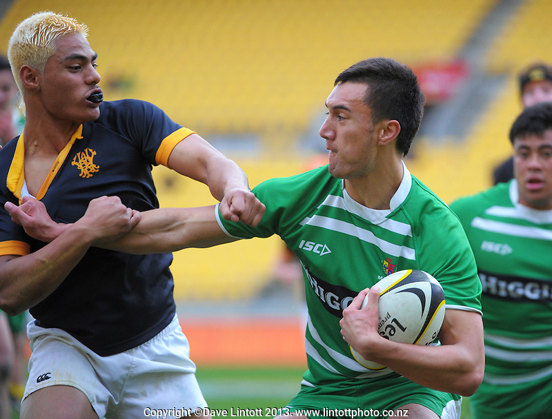 Cruz Pene (right) tries to hand off Fereti Soloa during the under-18 representative rugby match between Wellington and Manawatu at Westpac Stadium, Wellington, New Zealand on Saturday, 5 October 2013. Photo: Dave Lintott / lintottphoto.co.nz