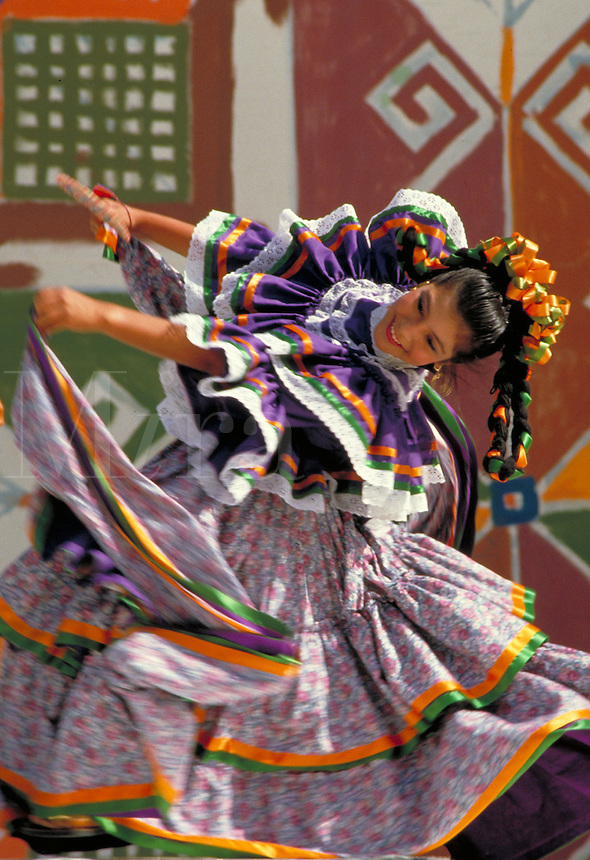 TRADITIONAL DANCE AT CULTURAL FESTIVAL PERFORMED BY HISPANIC TEEN DANCER. HISPANIC TEEN DANCER. OAKLAND CALIFORNIA.