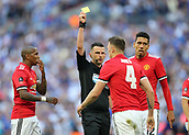 19th May 2018, Wembley Stadium, London, England; FA Cup Final football, Chelsea versus Manchester United; Referee Michael Oliver giving a yellow card to Phil Jones of Manchester United for fouling Eden Hazard of Chelsea and giving away the penalty