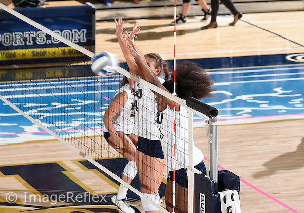 Florida International University women's volleyball outside hitter Autumn Martin (13) and middle blocker Gloria Levorin (4) play against  the University of Central Florida which won the match 3-0 on September 17, 2015 at Miami, Florida.