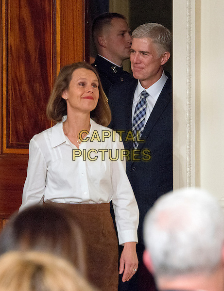 Judge Neil Gorsuch and his wife, Marie Louise, come into the East Room from the Green Room as United States President Donald J. Trump announces Judge Gorsuch as his nominee to be Associate Justice of the US Supreme Court to replace Justice Antonin Scalia in the East Room of the White House in Washington, DC on Tuesday, January 31, 2017.<br /> CAP/MPI/RS<br /> &copy;RS/MPI/Capital Pictures